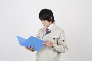 作業着の男性の写真